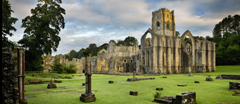 A view towards the East end of the Abbey church showing the great East window arch at Fountains Abbey, North Yorkshire.