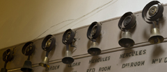 Servants bells in the ground floor corridor, next to the Kitchen, at Hanbury Hall, Worcestershire