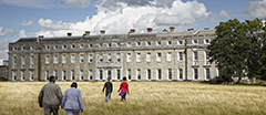 Visitors at the West front of Petworth House, West Sussex.