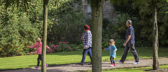 Visitors enjoying the gardens in September at East Riddlesden Hall, West Yorkshire.