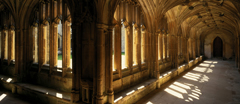 Looking down the interior of the north walk of the Cloisters at Lacock Abbey, Wiltshire.