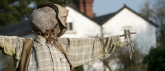 Scarecrow in the allotment gardens at Quarry Bank Mill, Wilmslow, Cheshire.