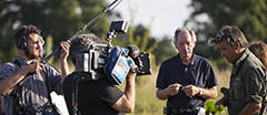 Presenter Michael Buerk with NT ranger Simon Damant during filming for the ITV television series 'Inside the National Trust' on the Wimpole Estate, Cambridgeshire.